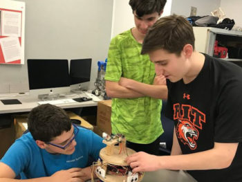 Boys at the STEM program working on a project