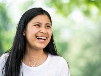 Female counselor in training laughing outside