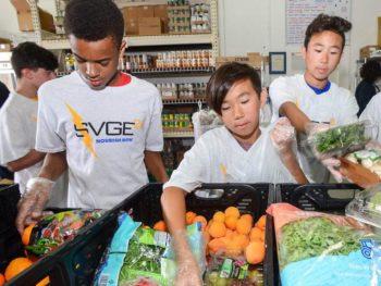 Kids volunteering at a food bank for community service program