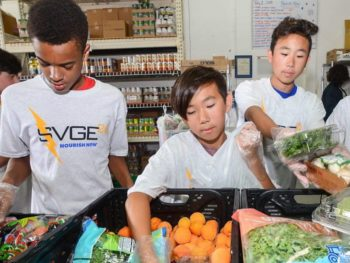 Kids volunteering at a food bank for community service program