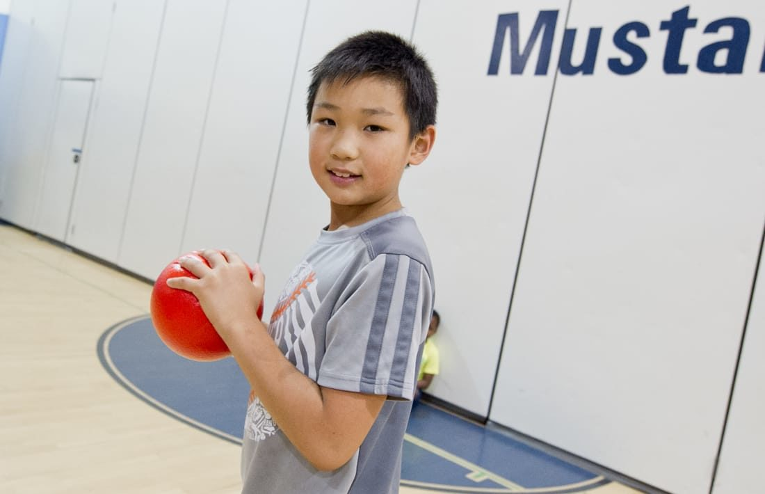 Boy playing dodgeball