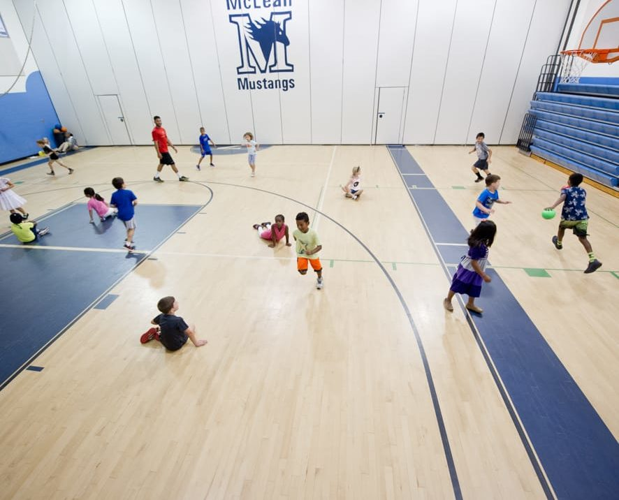 Kids playing dodgeball in the gym