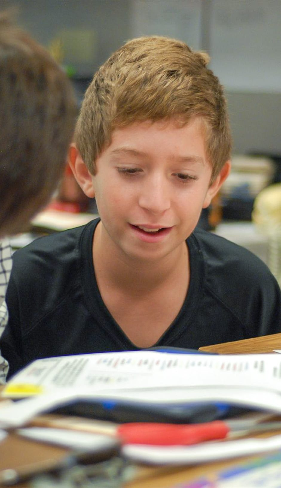Middle school student practicing his writing