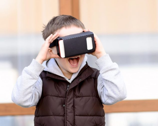 Boy using a virtual reality device