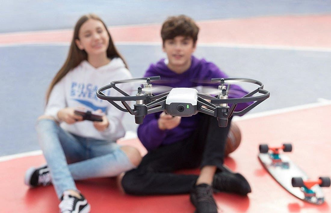 Kids flying a drone for STEM Action Flix