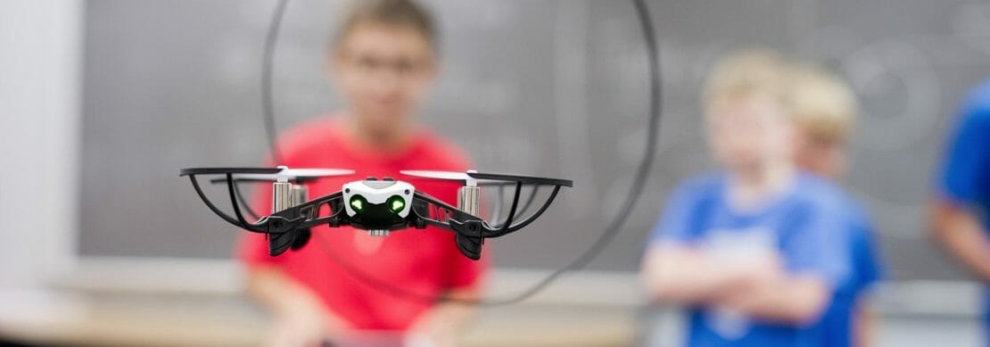 Children with a drone