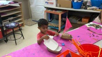 A student making a sailboat.